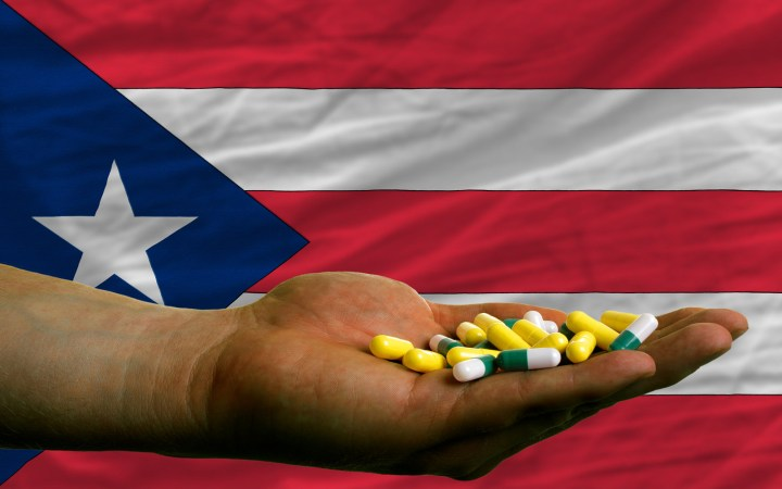 Holding Pills In Hand In Front Of Puertorico National Flag
